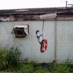 banksy-boy-on-lifebuoy