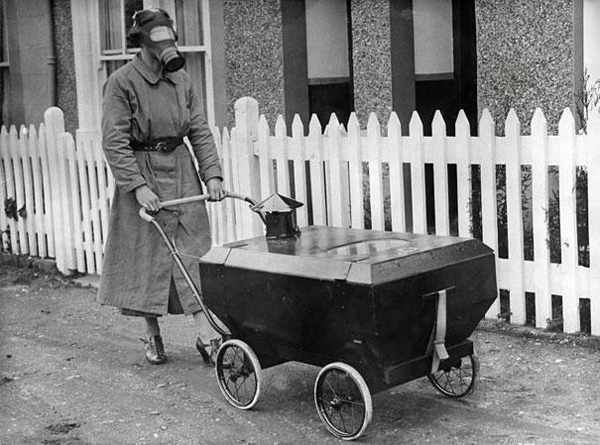 1.) A woman taking her baby for a stroll in a gas-resistant baby carriage.