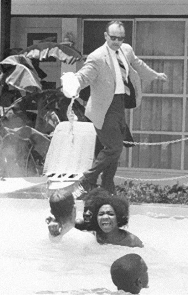 25.) A hotel owner pouring acid in a pool while a black family swam in it in 1964.