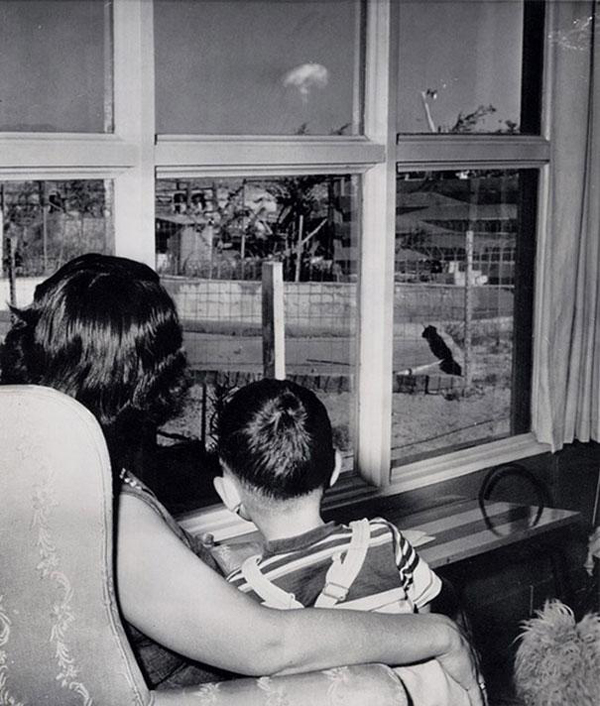 28.) A mother and her son look at the mushroom cloud following a nuclear test in Las Vegas in 1953.