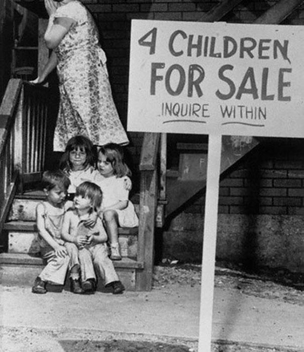 29.) A mother shamefully hides her face after listing her children for sale in 1948.